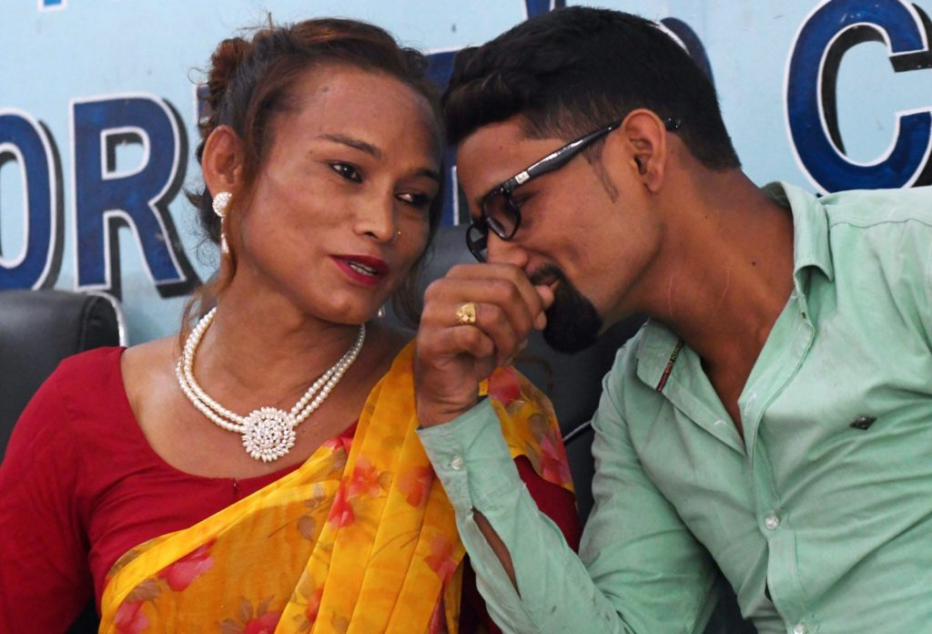 Nepali transgender woman Monika Shahi Nath (L) talks with her husband Ramesh Nath (R) during a press conference to announce the registration of their marriage, in Kathmandu on August 5, 2017. A Nepali transgender woman and a man registered their marriage, a first in the country, the couple said on August 5, despite an absence of laws legalising same-sex or transgender unions. Monika Shahi Nath, 40, who legally identifies as a third gender, married Ramesh Nath Yogi, 22, in May and was able to register it in their home district Dadeldhura in western Nepal last month. / AFP PHOTO / PRAKASH MATHEMA (Photo credit should read PRAKASH MATHEMA/AFP/Getty Images)