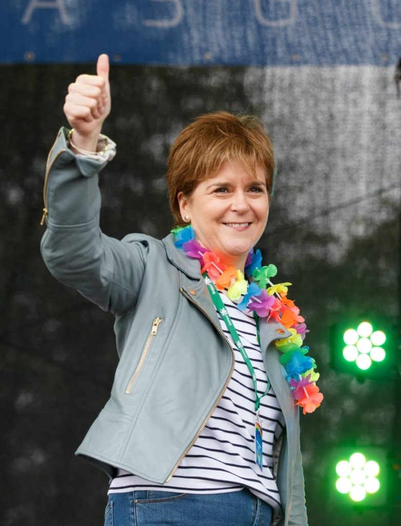 GLASGOW, SCOTLAND - AUGUST 19: First Minister Nicola Sturgeon gives the thumbs up as she addresses the assembled crowd at Glasgow Pride on August 19, 2017 in Glasgow, Scotland. The largest festival of LGBTI celebration in Scotland is held every year in Glasgow since 1996. (Photo by Robert Perry/Getty Images)