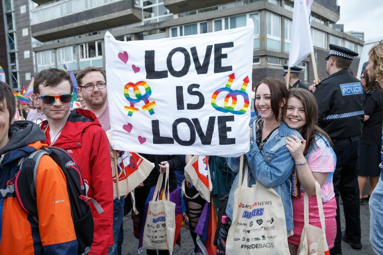 People hold up a sign during Glasgow Pride.