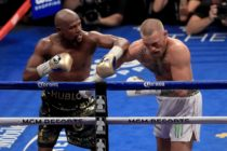 Mayweather punches McGregor
