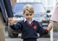 TOPSHOT - Britain's Prince George (C) accompanied by Britain's Prince William (L), Duke of Cambridge arrives for his first day of school at Thomas's school where he is met by Helen Haslem (R) head of the lower school in southwest London on September 7, 2017. / AFP PHOTO / POOL / RICHARD POHLE (Photo credit should read RICHARD POHLE/AFP/Getty Images)