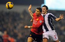 Manchester United's Portuguese midfielder Cristiano Ronaldo (L) vies with West Bromwich Albion's Belgium defender Carl Hoefkens during the English Premier league football match at The Hawthorns, West Bromwich, central England, on January 27, 2009. AFP PHOTO/ANDREW YATES FOR EDITORIAL USE ONLY Additional licence required for any commercial/promotional use or use on TV or internet (except identical online version of newspaper) of Premier League/Football League photos. Tel DataCo +44 207 2981656. Do not alter/modify photo. (Photo credit should read ANDREW YATES/AFP/Getty Images)
