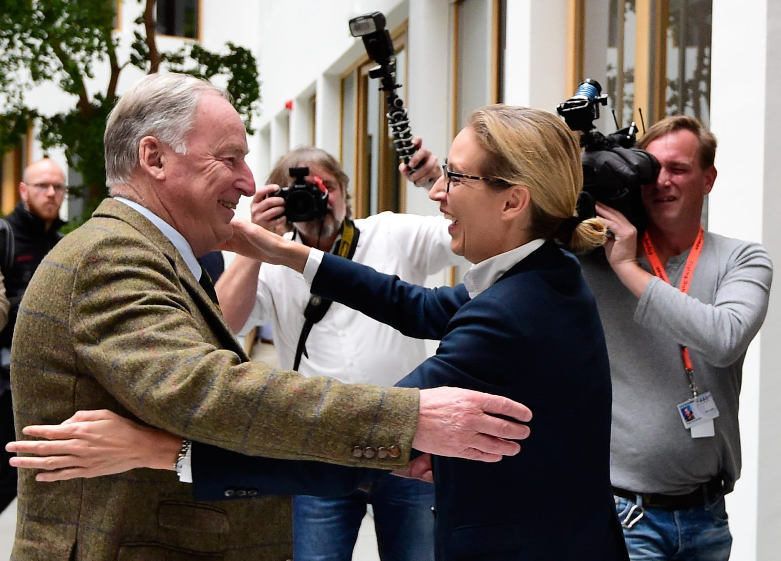 "Alexander Gauland (L) and Alice Weidel, both top candidates of Germany's nationalist Alternative for Germany (AfD) party, hug prior to a press conference in Berlin on September 25, 2017, one day after general elections. The election spelt a breakthrough for the anti-Islam Alternative for Germany (AfD), which with 12.6 percent became the third strongest party and vowed to ""go after"" chancellor Angela Merkel over her migrant and refugee policy. / AFP PHOTO / Tobias SCHWARZ (Photo credit should read TOBIAS SCHWARZ/AFP/Getty Images)"