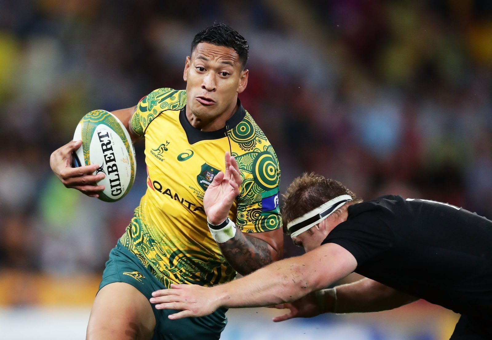 BRISBANE, AUSTRALIA - OCTOBER 21: Israel Folau of the Wallabies is tackled during the Bledisloe Cup match between the Australian Wallabies and the New Zealand All Blacks at Suncorp Stadium on October 21, 2017 in Brisbane, Australia. (Photo by Matt King/Getty Images)