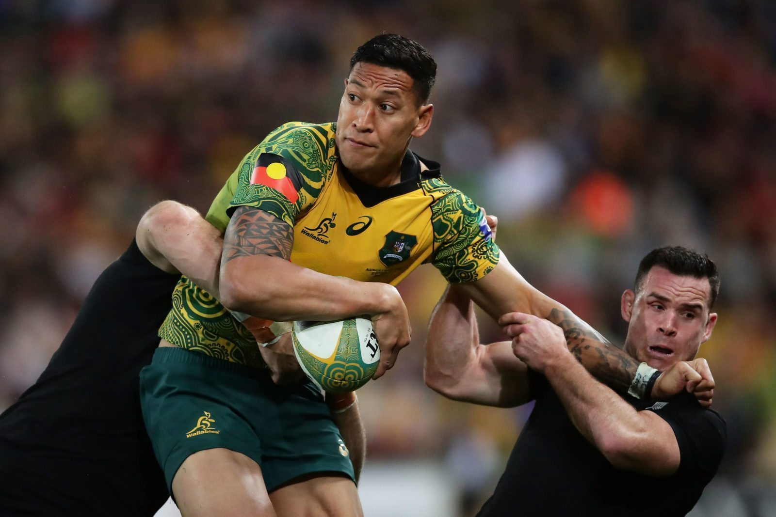 BRISBANE, AUSTRALIA - OCTOBER 21: Israel Folau of the Wallabies is tackled by Ryan Crotty of the All Blacks during the Bledisloe Cup match between the Australian Wallabies and the New Zealand All Blacks at Suncorp Stadium on October 21, 2017 in Brisbane, Australia. (Photo by Matt King/Getty Images)