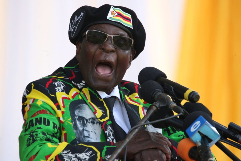 Zimbabwe's President Robert Mugabe delivers a speech during the Zimbabwe ruling party Zimbabwe African National Union- Patriotic Front (Zanu PF) youth interface Rally on November 4, 2017 in Bulawayo. / AFP PHOTO / ZINYANGE AUNTONY (Photo credit should read ZINYANGE AUNTONY/AFP/Getty Images)