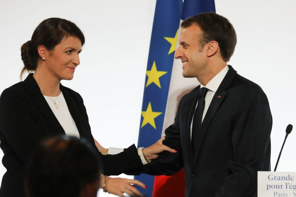 French President Emmanuel Macron (R) smiles to French Junior Minister for Gender Equality Marlene Schiappa after he delivered a speech during the International Day for the Elimination of Violence Against Women, on November 25, 2017 at the Elysee Palace in Paris. / AFP PHOTO / POOL / LUDOVIC MARIN (Photo credit should read LUDOVIC MARIN/AFP/Getty Images)