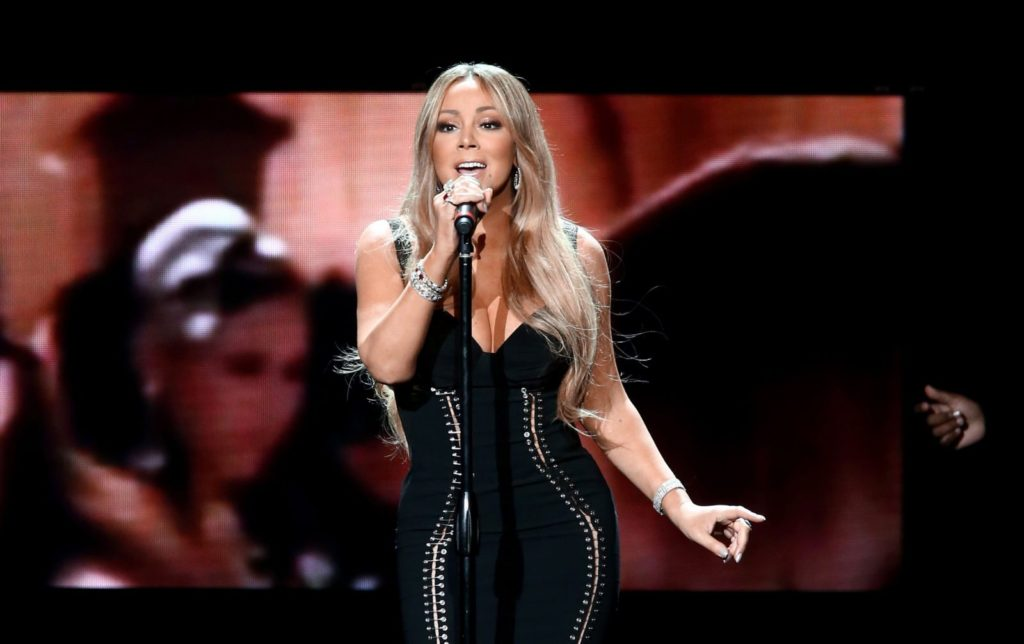 Mariah Carey performs onstage during the AHF World AIDS DAY Concert.
