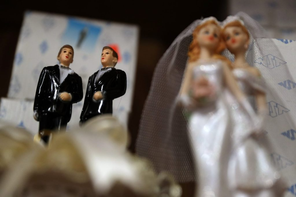 Wedding cake figures of a gay and lesbian married couples