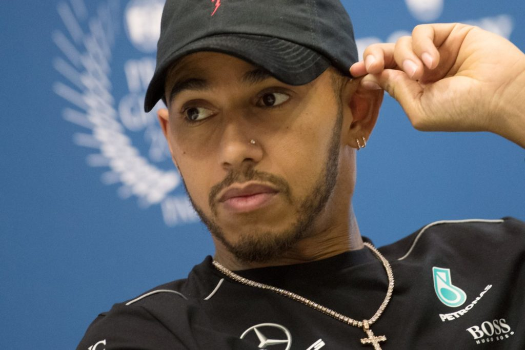World's Formula One British driver Lewis Hamilton attends a press conference of the FIA (International Automobile Federation) on December 8, 2017 in Paris. / AFP PHOTO / CHRISTOPHE SIMON (Photo credit should read CHRISTOPHE SIMON/AFP/Getty Images)
