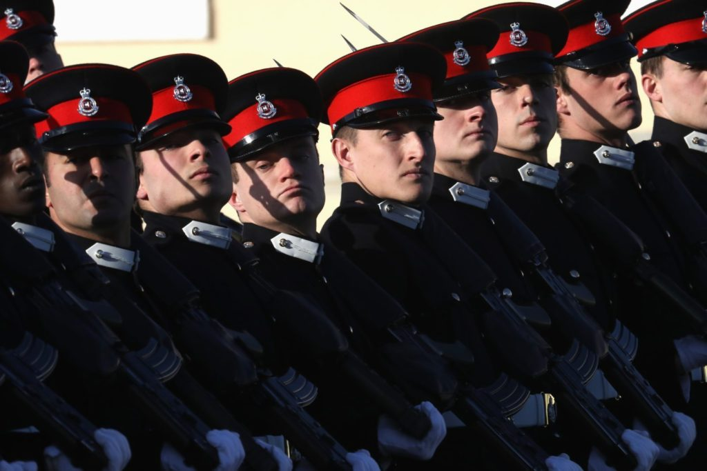 CAMBERLEY, ENGLAND - DECEMBER 15: Soldiers march at The Sovereign's Parade at Royal Military Academy Sandhurst on December 15, 2017 in Camberley, England. (Photo by Chris Jackson/Getty Images)
