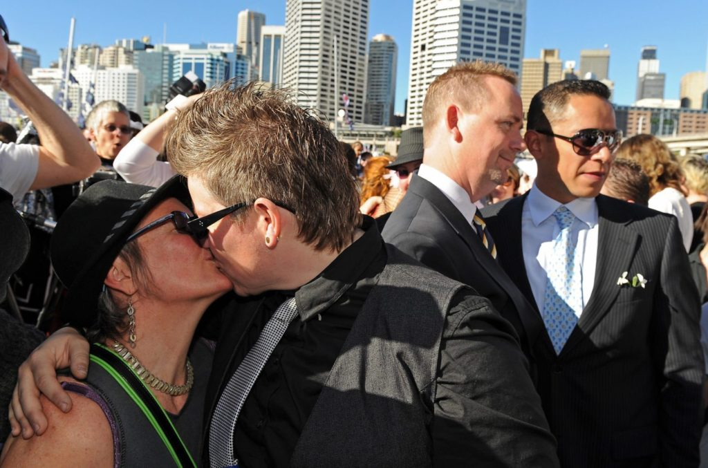 Lesbian and gay couples embrace outside the ruling Labor Party's conference during a mass 'illegal wedding' in Sydney on August 1, 2009. The national Labor conference voted to develop a system for the registration and recognition of same-sex relationships, after gay rights advocates failed to gather enough numbers for a resolution to legalise gay marriage. Australian Prime Minister Kevin Rudd won the 2007 election on a platform that supported the former conservative government's legal definition of marriage as a union between a man and a woman. AFP PHOTO/Torsten BLACKWOOD (Photo credit should read TORSTEN BLACKWOOD/AFP/Getty Images)