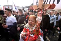 "A woman holds a cross as opponents to a treaty safeguarding women, backed by the Roman Catholic Church, protest against its ratification arguing it is imposing what they call a ""gender ideology in the Croatian capital, Zagreb, on March 24, 2018. Protestors against the Council of Europe convention -- the world's first binding instrument to prevent and combat violence against women, from marital rape to female genital mutilation -- hold banners against its ratification, an issue that has split the Balkan country. / AFP PHOTO / STR (Photo credit should read STR/AFP/Getty Images)"