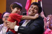 Presidential candidate of the ruling Citizens' Action Party (PAC), Carlos Alvarado, picks up his son Gabriel, during a campaign rally in San Jose, Costa Rica, on March 24, 2018. / AFP PHOTO / Ezequiel BECERRA (Photo credit should read EZEQUIEL BECERRA/AFP/Getty Images)