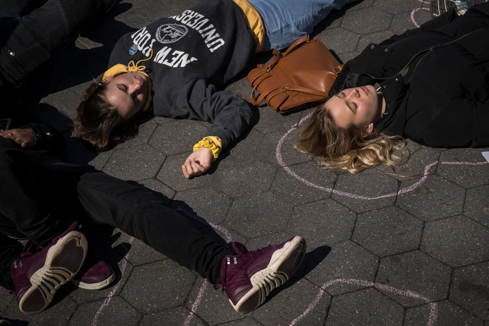 NEW YORK, NY - APRIL 20: Student activists participate in a 'die-in' to protest gun violence at Washington Square Park, near the campus of New York University, April 20, 2018 in New York City. On the anniversary of the 1999 Columbine High School mass shooting, student activists across the country are participating in school walkouts to demand action on gun reform. (Photo by Drew Angerer/Getty Images)