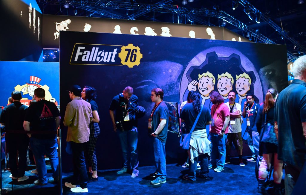 Gaming fans wait in line for freebies from Bethesda's Fallout 76 game.