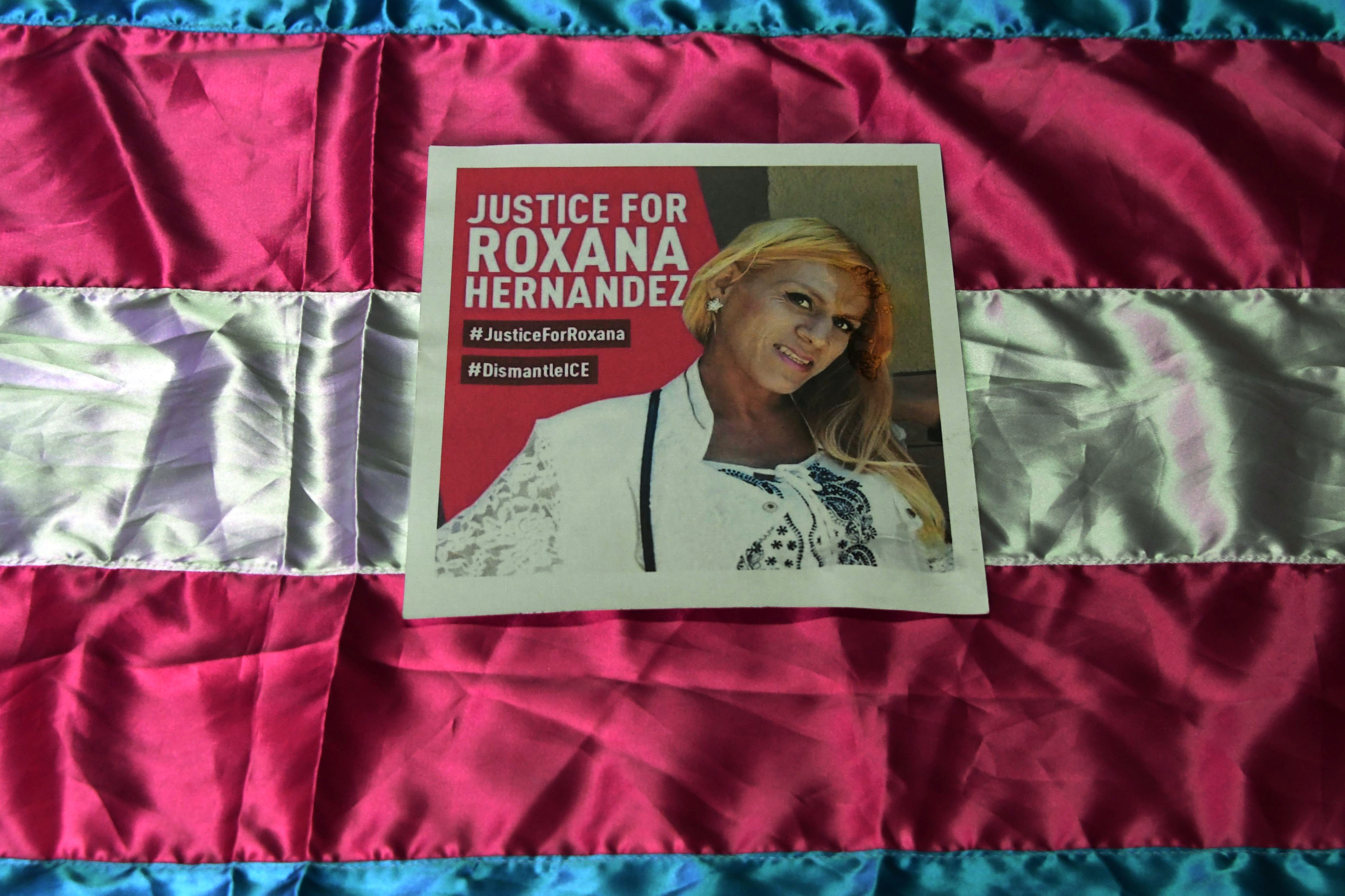 """A poster demanding justice in the death of Honduran transgender woman Roxana Hernandez, who died of pneumonia, dehydration and """"complications associated with HIV,"""" while in ICE custody."""