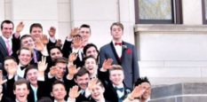 Jordan Blue stands defiant as many of his classmates do a 'mass Nazi salute'
