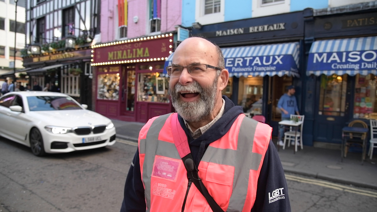 Dave has a laugh on a shift with the Soho Angels in London (PinkNews)
