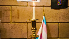A candle mourns transgender victims of violence like Tydie, who was killed in Baltimore.
