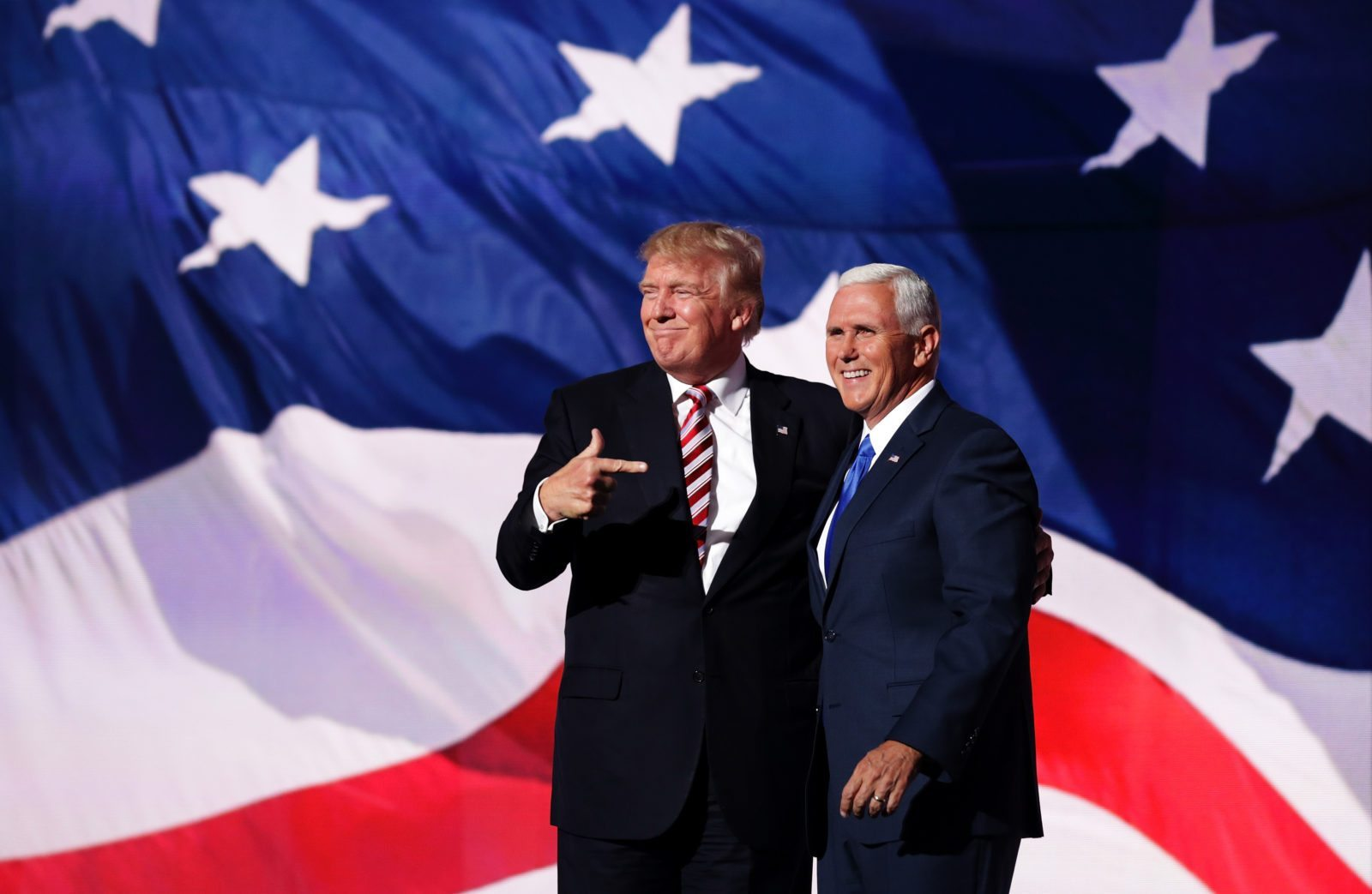 CLEVELAND, OH - JULY 20: Republican presidential candidate Donald Trump stand with Republican vice presidential candidate Mike Pence and acknowledge the crowd on the third day of the Republican National Convention on July 20, 2016 at the Quicken Loans Arena in Cleveland, Ohio. Republican presidential candidate Donald Trump received the number of votes needed to secure the party's nomination. An estimated 50,000 people are expected in Cleveland, including hundreds of protesters and members of the media. The four-day Republican National Convention kicked off on July 18. (Photo by Chip Somodevilla/Getty Images)