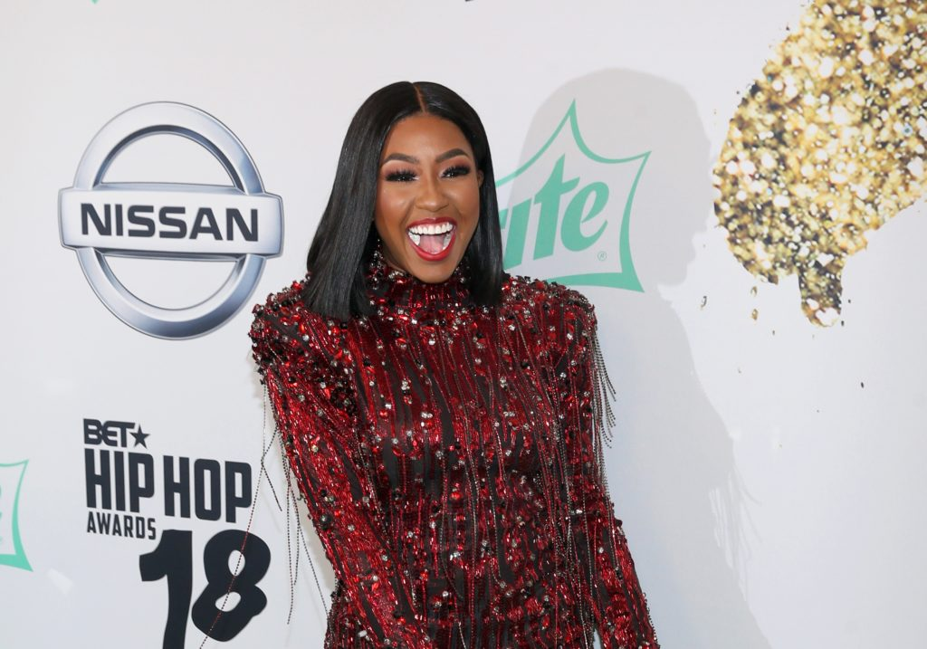 Photo of Rapper Yung Miami of the City Girls. Rapper who would 'beat' gay son