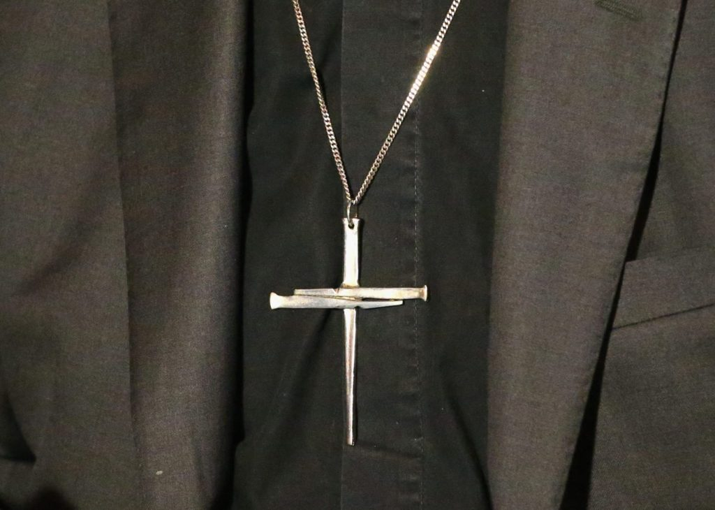 MELBOURNE, AUSTRALIA - AUGUST 13: A detail of the cross necklace worn by The Archbishop of Canterbury, Justin Welby as he speaks during a press conference ahead of Archbishop Philip Freier's inauguration as Primate of Austalia at The Cathedral Chapter House on August 13, 2014 in Melbourne, Australia. It is the first visit to Australia by the spiritual head of the worldwide Anglican Communion since 1997. (Photo by Scott Barbour/Getty Images)