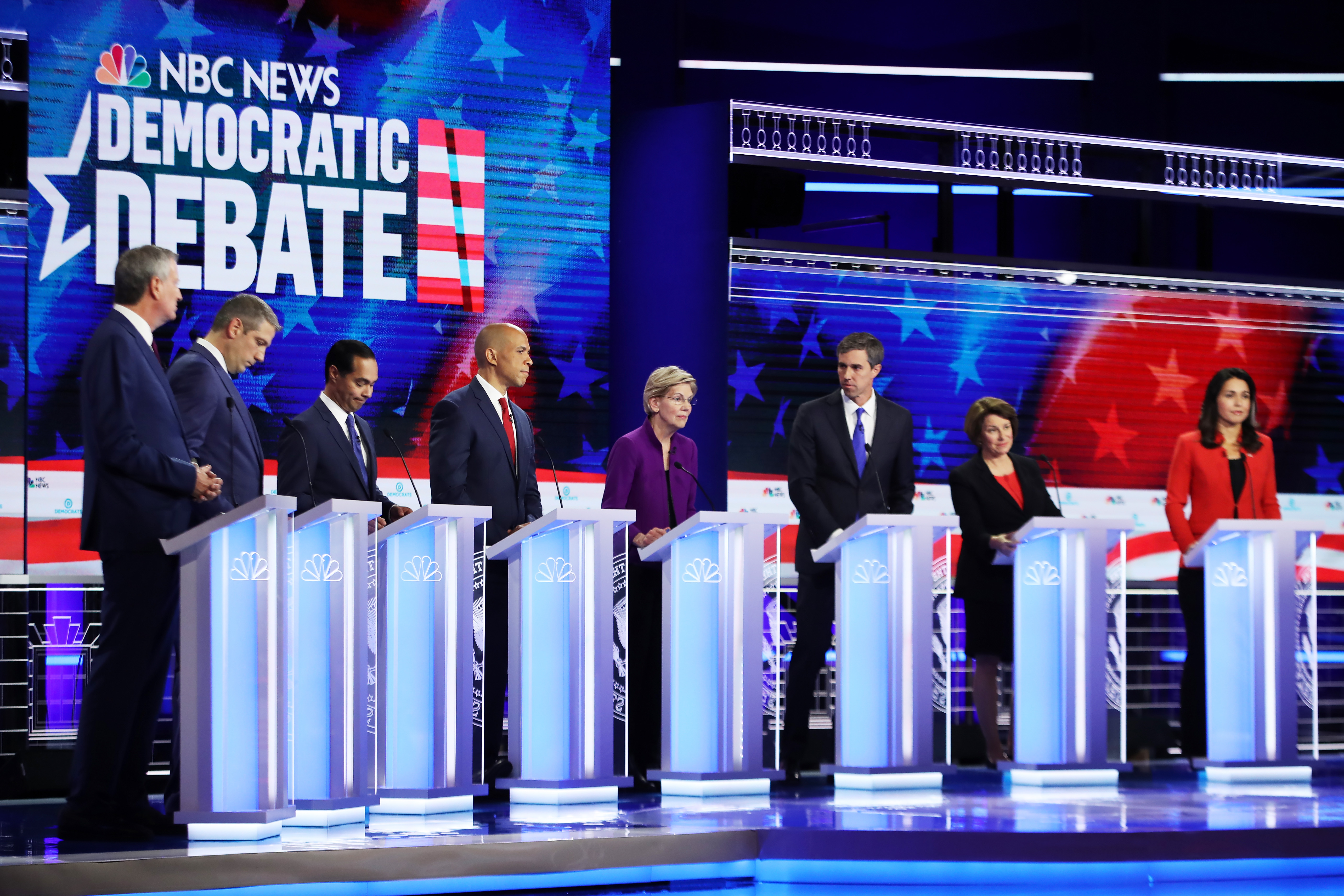 Democratic presidential candidates New York City Mayor Bill De Blasio, Rep. Tim Ryan, former housing secretary Julian Castro, Sen. Cory Booker, Sen. Elizabeth Warren, former Texas congressman Beto O'Rourke, Sen. Amy Klobuchar and Rep. Tulsi Gabbard face off in the first Democrats presidential debate on June 26, 2019 in Miami, Florida.