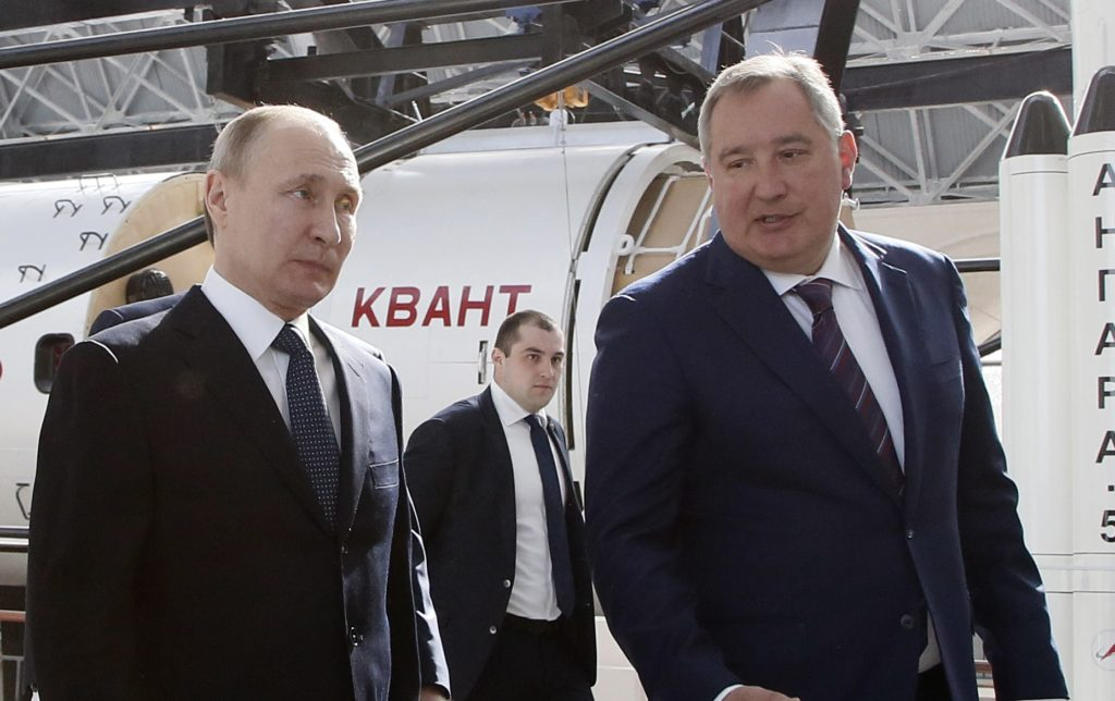Russian President Vladimir Putin talks with Russian Deputy Prime Minister and Head of ROSCOSMOS Dmitry Rogozin