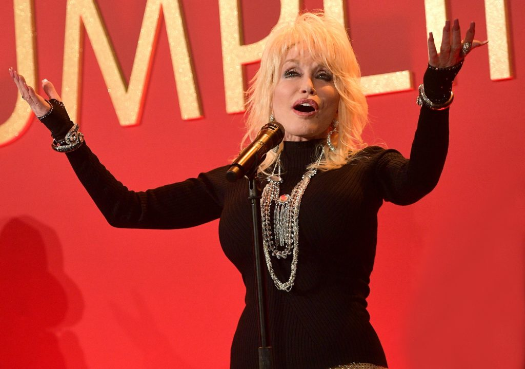 Dolly Parton performs onstage at a luncheon for the Netflix Film Dumplin' at Four Seasons Hotel Los Angeles