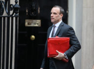 Dominc Raab carrying a red ministerial box
