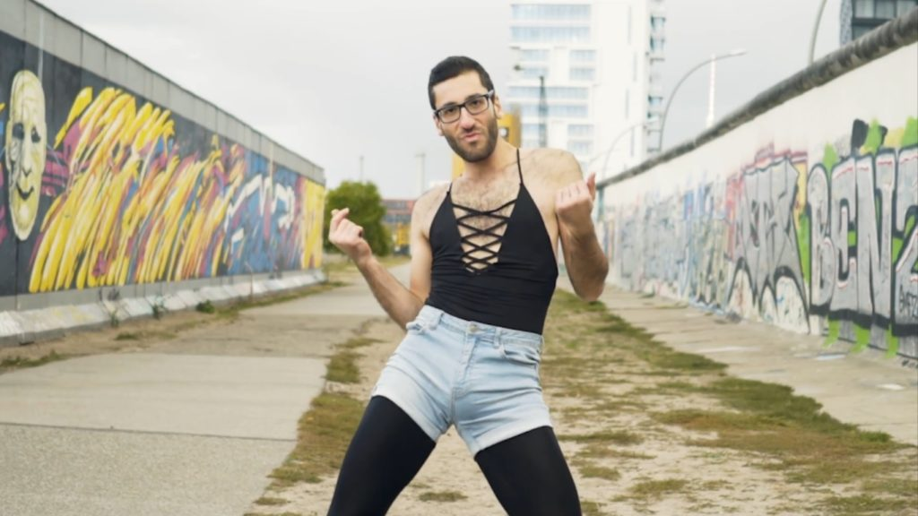 A still from a video of the founder of queer protest group WERK for Peace, Firas Nasr, dancing at the Berlin Wall