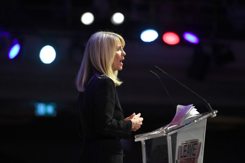 Esther McVey speaking at a podium