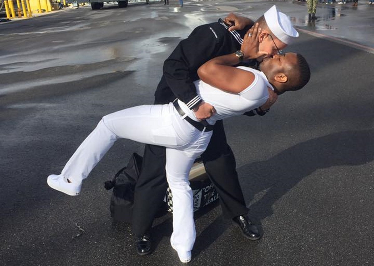 Bryan Woodington and Kenneth Woodington kissing after Bryan gets back from seven months in the Middle East on the USS The Sullivans