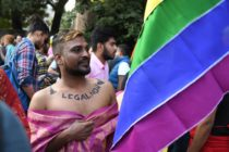 "A man with ""legal now"" takes part in a pride parade in Delhi on November 25, 2018, the first since the Supreme Court decriminalised gay sex, a landmark moment defining 2018"