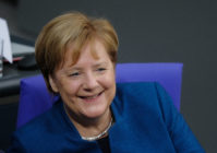 German Chancellor Angela Merkel sits down at the Bundestag