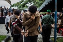 Gay men in Indonesia being led to be lashed 83 times for having gay sex