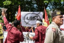 A group of Muslim protesters march with banners against the LGBT community in Banda Aceh on Decmber 27, 2017