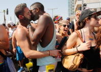 Two men kissing at Israel Pride