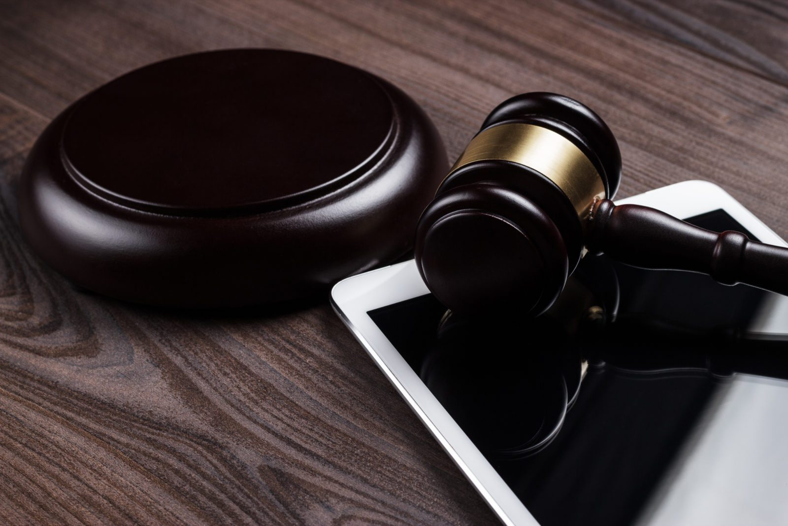 judge gavel and tablet computer on the table