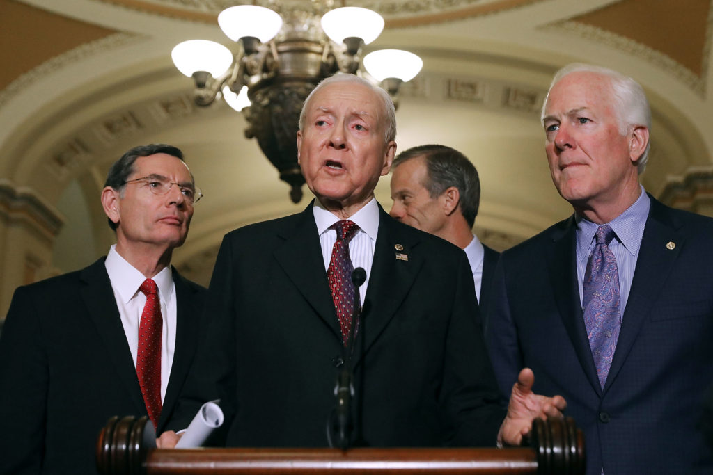 Senator John Barrasso, Senate Finance Committee Chairman Orrin Hatch, Sen. John Thune and Senate Majority Whip John Cornyn talk with reporters following the weekly Senate Republican Policy Committee luncheon in the US Capitol