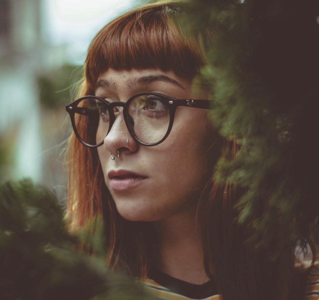 Girl with glasses and septum piercing