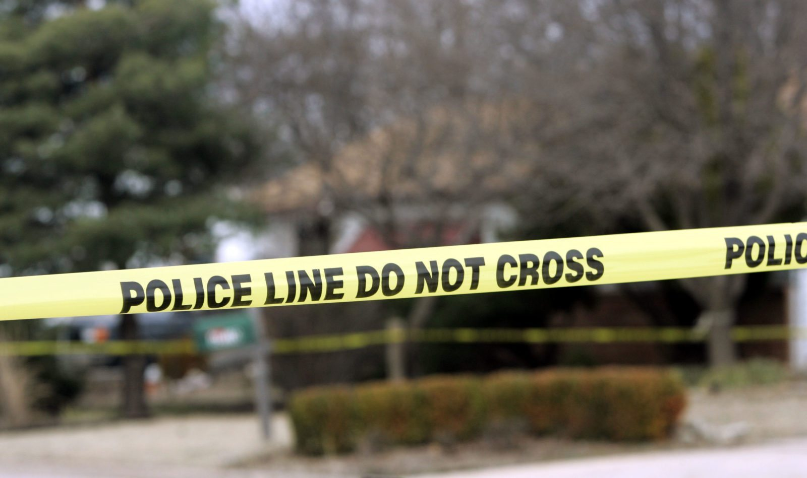 PARK CITY, KS - FEBRUARY 26: Police tape hangs across the street in front of the house that Dennis Rader lives in February 26, 2005 in Park City, Kansas. Rader is the suspect whom police have arrested on suspicion of first-degree murder in connection with the 10 deaths now tied to the serial killer known as BTK. (Photo by Larry W. Smith/Getty Images)PARK CITY, KS - FEBRUARY 26: Police tape hangs across the street in front of the house that Dennis Rader lives in February 26, 2005 in Park City, Kansas. Rader is the suspect whom police have arrested on suspicion of first-degree murder in connection with the 10 deaths now tied to the serial killer known as BTK. (Photo by Larry W. Smith/Getty Images)