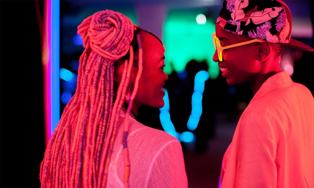 The two main characters in Rafiki look at each other