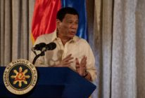 Philippine President Rodrigo Duterte speaking at a podium