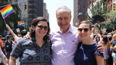 Alison Schumer poses with her father Senator Chuck Schumer and her fiancée Elizabeth Weiland at the NYC Pride Parade.