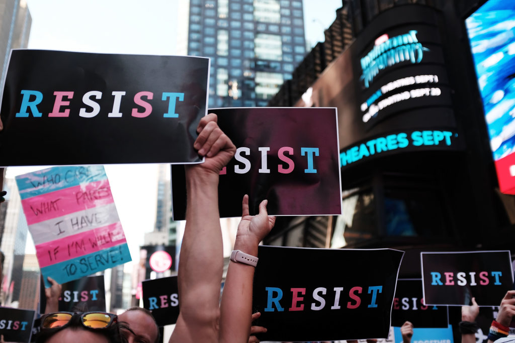 Dozens of protesters gather in Times Square near a military recruitment center to show their anger at President Donald Trump's decision to reinstate a ban on trans folk from serving in the militar. (Spencer Platt/Getty Images)