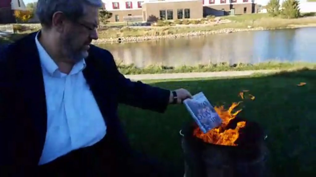Paul Dorr burning LGBT Children's books