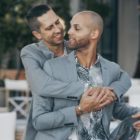New York City married couple Alex Majkowski and Taray Carey embrace