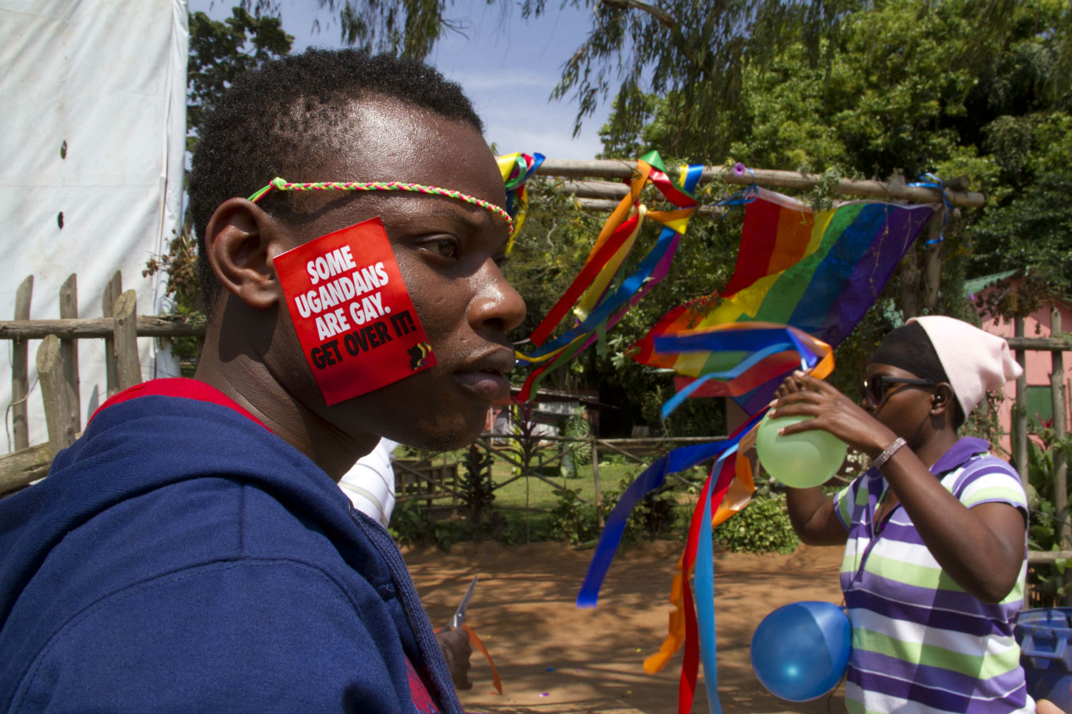 A Ugandan man with a sticker on his face takes part on August 9, 2014 in the annual gay pride in Entebbe, Uganda